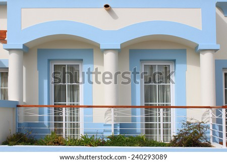 Closeup of veranda and windows decorated in a pastel blue and white in Algarve, Portugal - stock photo