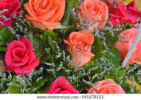 closeup of vibrant orange roses flower bouquet - stock photo