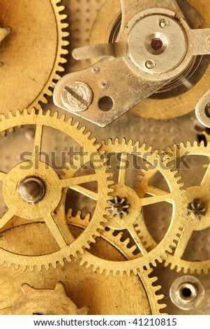 Closeup of vintage brass clock mechanism. Conceptual background