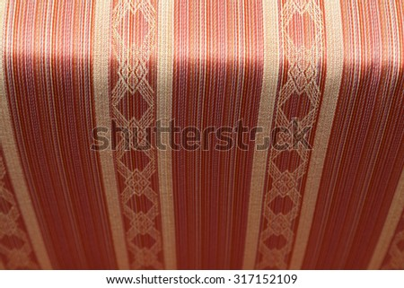 Closeup of vintage fabric textile with selective focus - stock photo