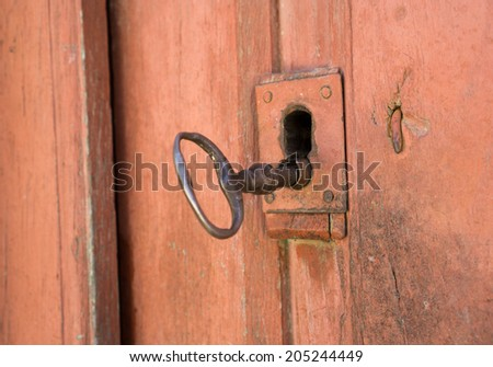 Closeup of vintage lock and door with antique key - stock photo