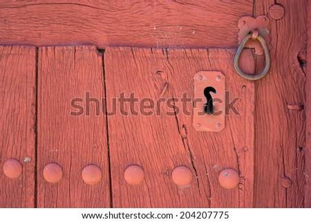 Closeup of vintage lock and doorknocker, wooden door - stock photo