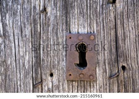 Closeup of vintage lock and wooden door - stock photo