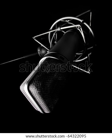 closeup of vintage microphone on a black background - stock photo