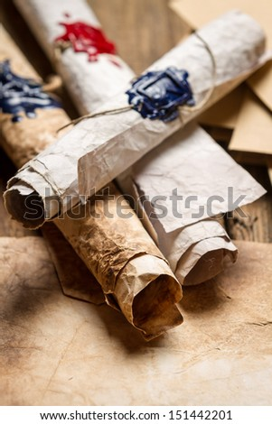 Closeup of vintage scrolls with wax - stock photo