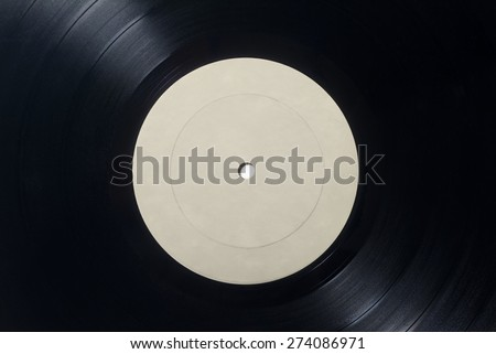 Closeup of Vinyl Long Play Record with Label with Copy Space. - stock photo