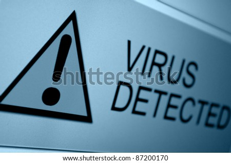 Closeup of Virus Detected Sign on LCD Screen - stock photo