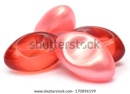 Closeup of vitamin e capsule over white background - stock photo