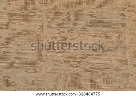 Closeup of wall concrete surface that made by yellow-brown color concrete - stock photo