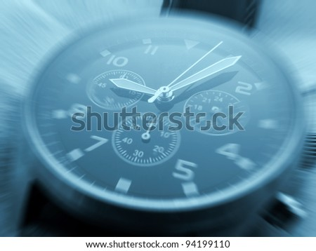 Closeup of watch face with zoom effect and cyan toned - stock photo