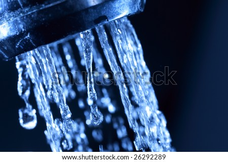 Closeup of water coming from a kitchen sink - stock photo