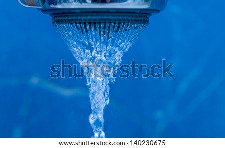 Closeup of water coming from a kitchen sink. Shower head and water drops - levitation water - stock photo
