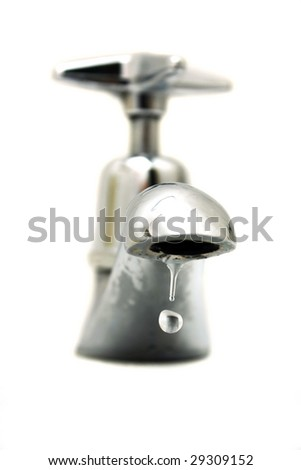 Closeup of water dropping from silver faucet. - stock photo