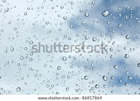 Closeup of water drops on glass surface - stock photo