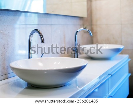 Closeup of water-supply faucet in modern bathroom - stock photo