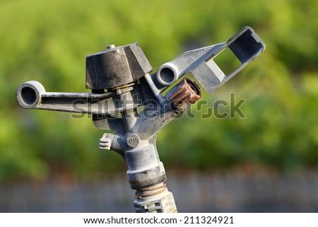 Closeup of watering equipment fields - stock photo