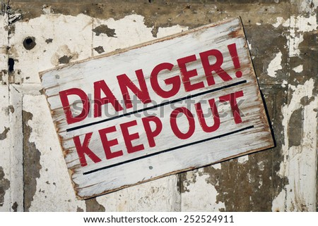 Closeup of weathered Danger Keep Out sign - stock photo