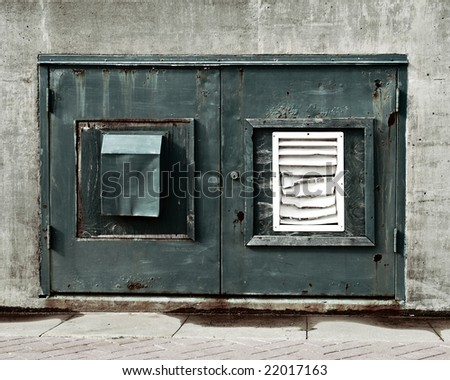 closeup of weathered doors on utility room - stock photo