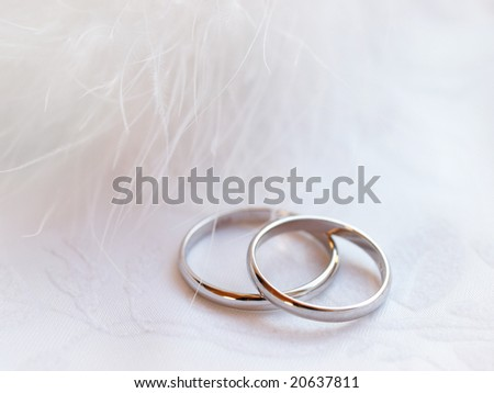 Closeup of wedding rings on a white textile