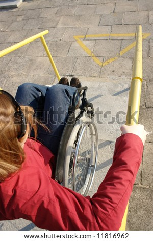 Closeup of wheelchair woman going down the concrete stairs - stock photo