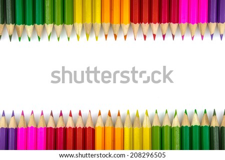 Closeup of White background with multicolored crayon