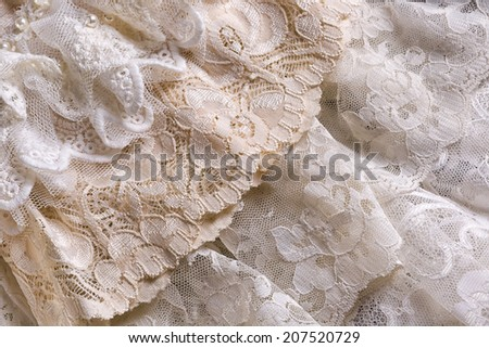 Closeup of white beige and ivory vintage lace fabrics - stock photo