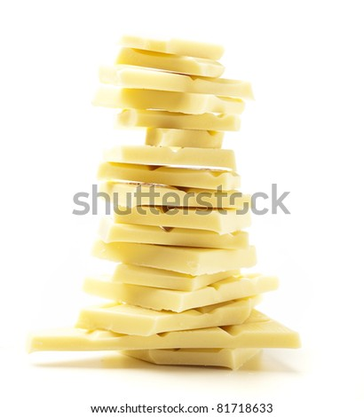 closeup of white chocolate pieces on white background - stock photo