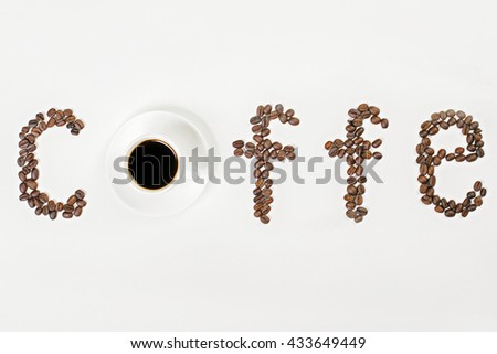 Closeup of white coffee cup and saucer on desktop with coffee beans. Selective focus, Mock up - stock photo