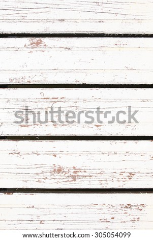 Closeup of white colored timbered fence. Wooden background - stock photo