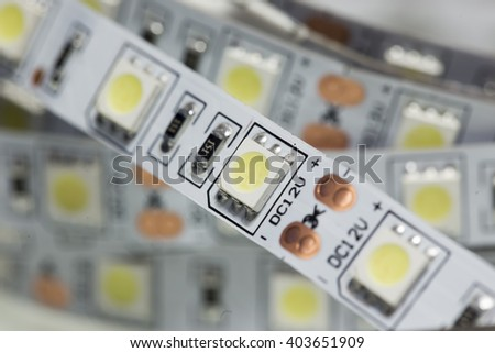 Closeup of white LED strip with SMD components