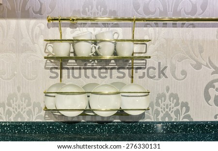 Closeup of white plates in a cupboard. - stock photo