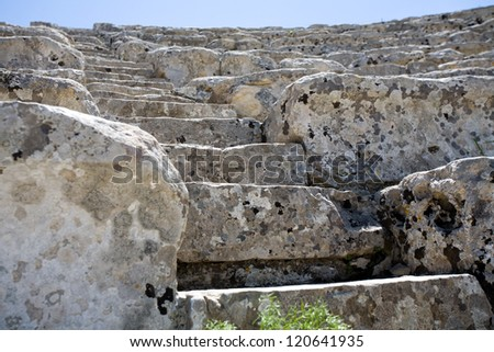 closeup of white steps of ancient Greek amphitheatre, Segesta village, Sicily, Italy - stock photo