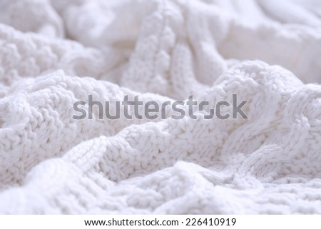 Closeup of white wool coiled rope cable knitting stitch background - stock photo