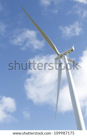 Closeup of wind turbine and blue sky