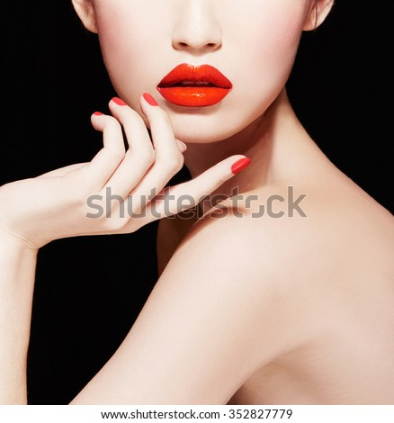 Closeup of woman face and body. Beautiful makeup with red lips, nail polish manicure.isolated on black.  - stock photo