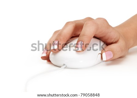 Closeup of woman hand holding mouse over isolated background - stock photo