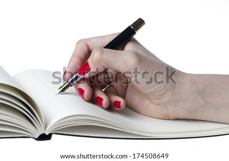 Closeup of woman hand holding pen on notebook isolated on white background - stock photo