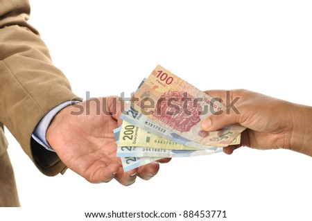 Closeup of woman handing Mexican pesos to man, on white background - stock photo