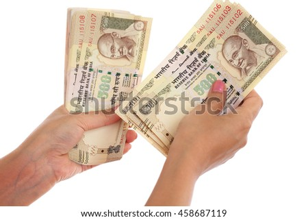 Closeup of woman hands counting money against white background