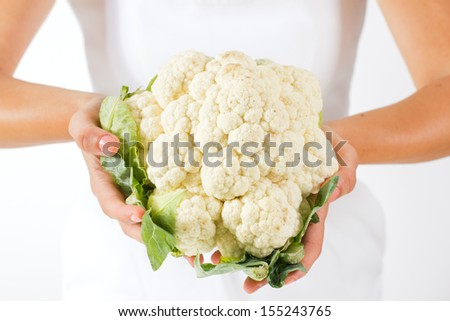 Closeup of woman hands holding cauliflower. - stock photo