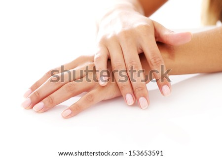 Closeup of woman hands with manicure over a white background - stock photo