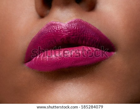 closeup of woman sexy lips with pink lipstick on tanned skin - stock photo