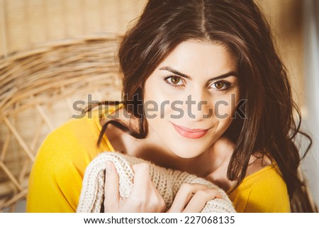 Closeup of woman smiling and feeling cozy. Instagram vintage filter - stock photo