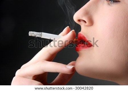 closeup of woman smoking a cigarette - stock photo