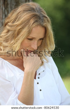 Closeup of woman thinking in park