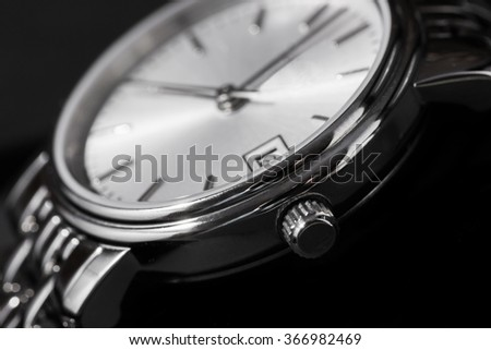 Closeup of woman watch on a black background
