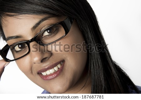 Closeup of woman wearing framed glasses on her face - stock photo
