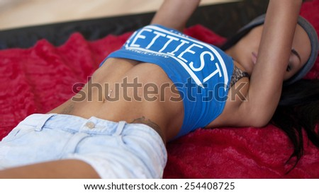closeup of women abdomen and flat tummy. sexy body in texas shorts  - stock photo