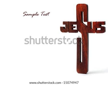 Closeup of wood crucifix on white background - stock photo