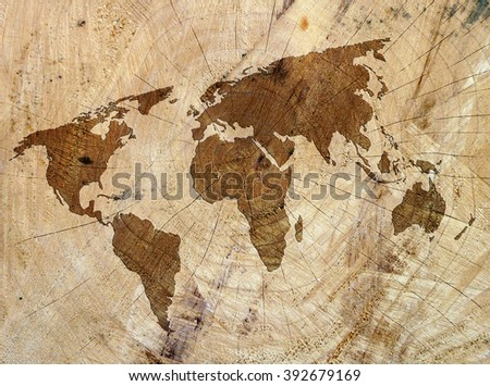 Closeup of wood texture overlaid with outline map of world